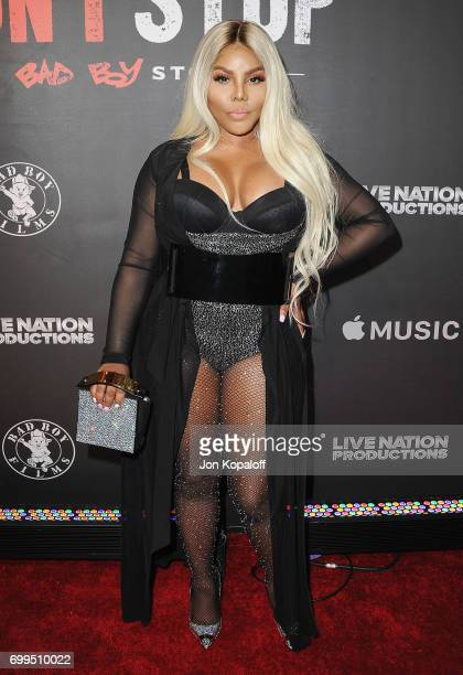 Lil' Kim arrives at the Los Angeles Premiere Of 'Can't Stop Won't Stop' at Writers Guild of America West on June 21 2017 in Los Angeles California