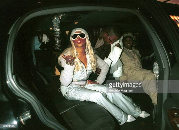 Lil'' Kim arrives in style as a guest at the grand opening of Chanel Soho on Spring Street December 5 2000 in New York City
