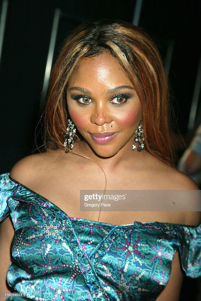 Lil Kim during Olympus Fashion Week Spring 2006 - Marc Jacobs - Front Row and Backstage at N.Y. State Armory in New York City, New York, United States.