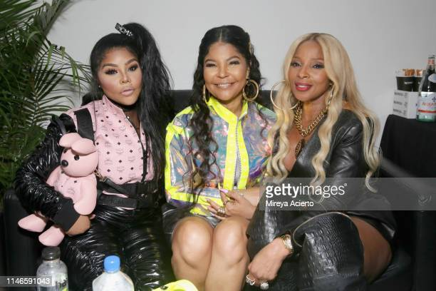 Lil' Kim Misa Hylton Brim and Mary J Blige attend the premiere of The Remix Hip Hop x Fashion at Tribeca Film Festival at Spring Studios on May 02...