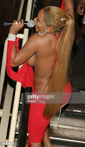Lil' Kim performs at the Patricia Field for Candies Spring Footwear and Handbag Collections Launch Party during Olympus Fashion Week Spring 2005 on...