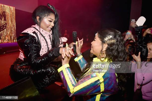 Lil' Kim performs for Misa Hylton Brim during the premiere of The Remix Hip Hop x Fashion at Tribeca Film Festival at Spring Studios on May 02 2019...