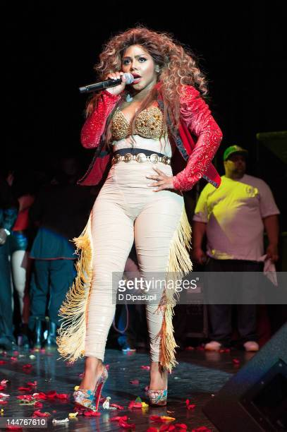 Lil' Kim performs on stage at Paradise Theater on May 18 2012 in New York City