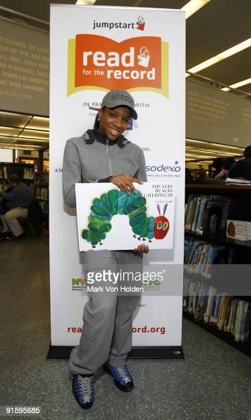 Lil' Mama poses at Jump Start's 'Read for the Record' event at Brooklyn Public Library's Central Library on October 8 2009 in the Brooklyn borough of...