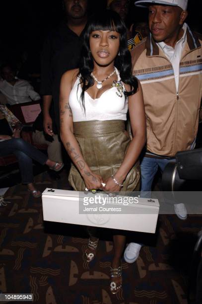 Lil Mo and Russell Simmons during Olympus Fashion Week Spring 2006 Baby Phat Front Row and Backstage at Radio City Music Hall in New York City New...