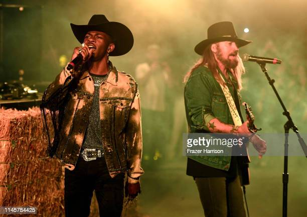 Lil Nas X and Billy Ray Cyrus perform onstage during the 2019 Stagecoach Festival at Empire Polo Field on April 28 2019 in Indio California