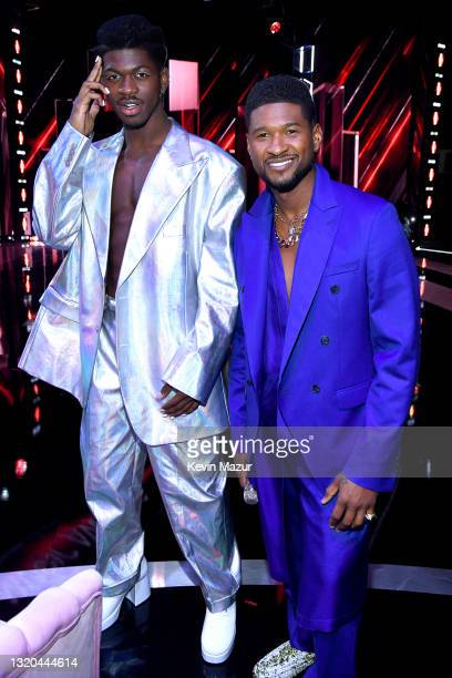 Lil Nas X and host Usher attend the 2021 iHeartRadio Music Awards at The Dolby Theatre in Los Angeles, California, which was broadcast live on FOX on...