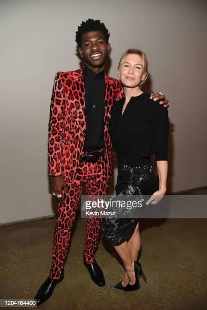 Lil Nas X and Renée Zellweger attend the Tom Ford AW20 Show at Milk Studios on February 07 2020 in Hollywood California