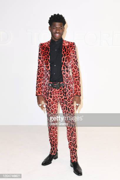 Lil Nas X attends the Tom Ford AW20 Show at Milk Studios on February 07 2020 in Hollywood California