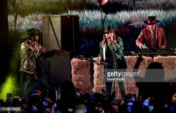 Lil Nas X Billy Ray Cyrus and Diplo perform onstage during the 2019 Stagecoach Festival at Empire Polo Field on April 28 2019 in Indio California