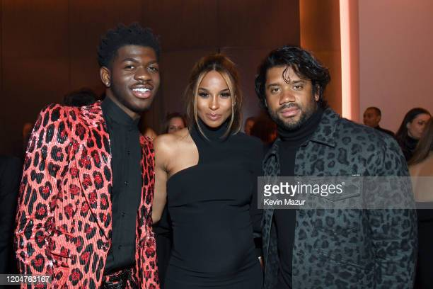 Lil Nas X Ciara and Russell Wilson attend the Tom Ford AW20 Show at Milk Studios on February 07 2020 in Hollywood California