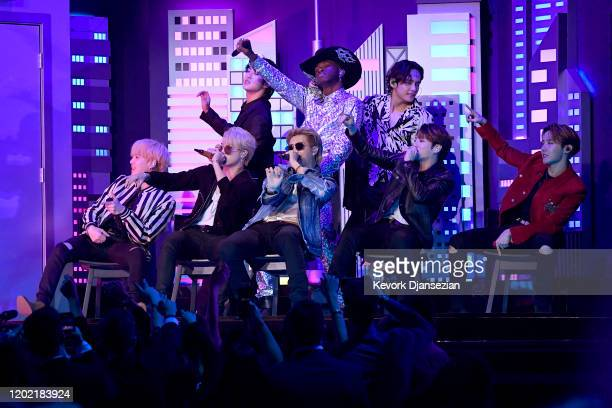 Lil Nas X performs with Jin V SUGA Jimin RM JHope and Jungkook of BTS onstage during the 62nd Annual GRAMMY Awards at Staples Center on January 26...