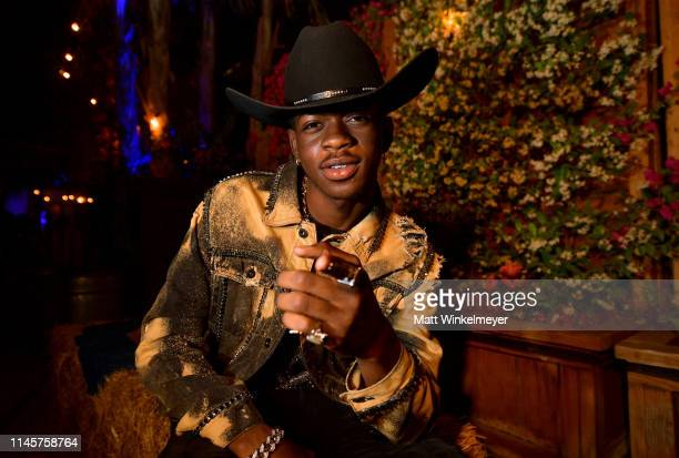 Lil Nas X poses backstage during the 2019 Stagecoach Festival at Empire Polo Field on April 28 2019 in Indio California