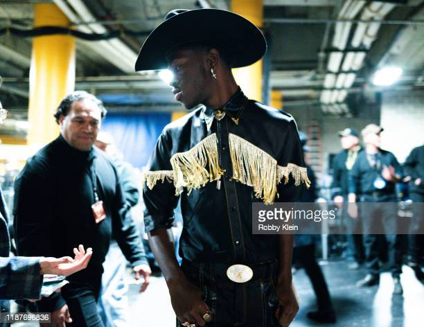 Lil Nas X poses backstage during the 53rd annual CMA Awards at Bridgestone Arena on November 13 2019 in Nashville Tennessee