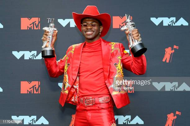 Lil Nas X poses with awards in the Press Room during the 2019 MTV Video Music Awards at Prudential Center on August 26 2019 in Newark New Jersey
