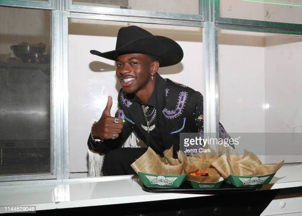 Lil Nas X teams up with Wingstop at the Old Town Road premiere party on May 17 2019 in West Hollywood California