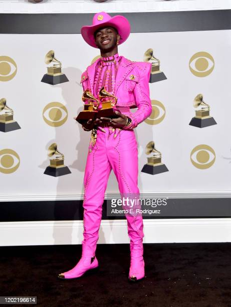 """Lil Nas X, winner of Best Pop Duo/Group Performance for """"Old Town Road"""" and Best Music Video for """"Old Town Road """", poses in the press room during the..."""