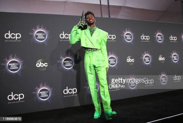 """Lil Nas X winner of the Favorite Song Rap/HipHop for """"Old Town Road"""" ft Billy Ray Cyrus poses in the press room during the 2019 American Music Awards..."""