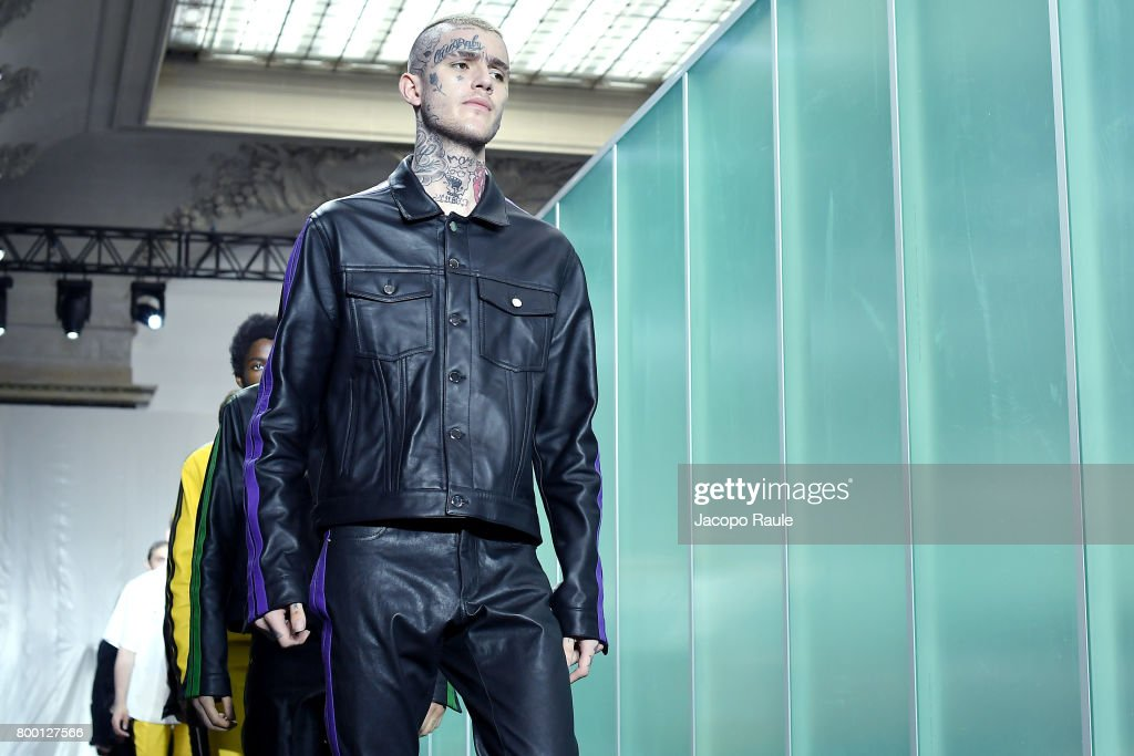 Lil Peep walks the runway during the Vlone Menswear Spring/Summer 2018 show as part of Paris Fashion Week on June 23, 2017 in Paris, France.