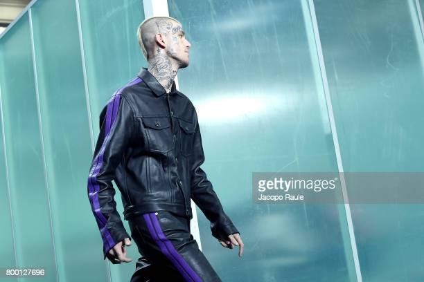 Lil Peep walks the runway during the Vlone Menswear Spring/Summer 2018 show as part of Paris Fashion Week on June 23 2017 in Paris France