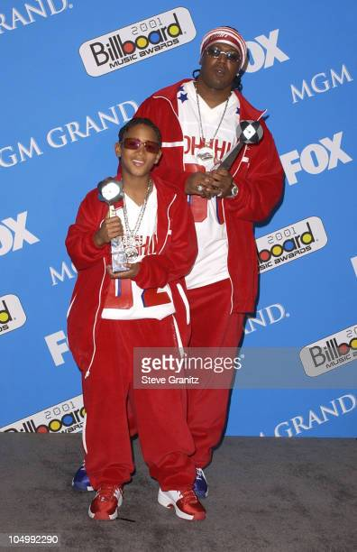 Lil' Romeo and Master P pose backstage with his award for Rap Artist of the Year at the 2001 Billboard Music Awards at the MGM Grand Hotel in Las...