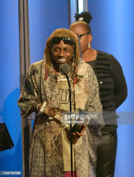 Lil Wayne accepts an award onstage during the BET Hip Hop Awards 2018 at Fillmore Miami Beach on October 6 2018 in Miami Beach Florida