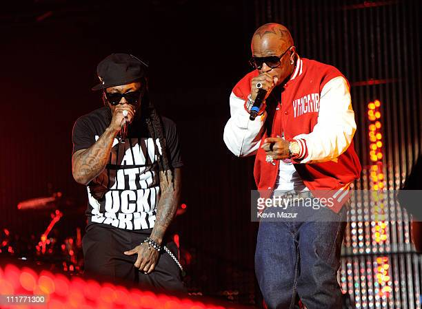 Lil Wayne and Birdman perform during his I Am Still Music tour at Nassau Veterans Memorial Coliseum on March 28 2011 in Uniondale New York
