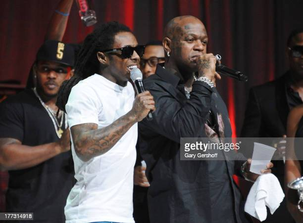 Lil Wayne and Birdman perform onstage at the 2013 BMI RB/HipHop Award at Hammerstein Ballroom on August 22 2013 in New York City