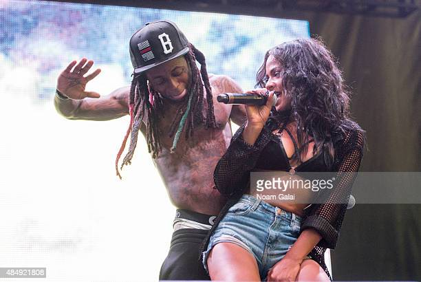 Lil Wayne and Christina Milian perform onstage during the 2015 Billboard Hot 100 Music Festival at Nikon at Jones Beach Theater on August 22 2015 in...