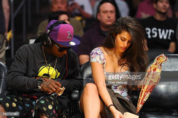 Lil Wayne and Dhea Sodano attend a basketball game between the Miami Heat and the Los Angeles Lakers at Staples Center on March 4 2012 in Los Angeles...