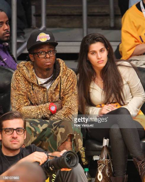 Lil Wayne and Dhea Sodano attend the Los Angeles Lakers vs Chicago Bulls game on December 25 2011 in Los Angeles California