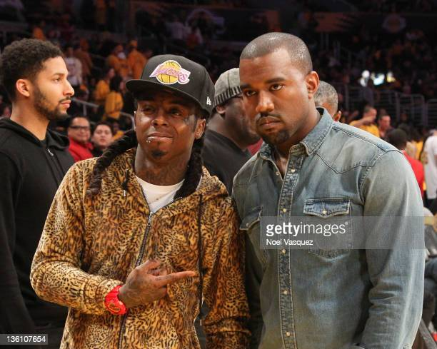 Lil Wayne and Kanye West attend the Los Angeles Lakers vs Chicago Bulls game on December 25 2011 in Los Angeles California