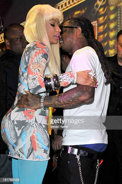 Lil Wayne and Nicki Minaj hug inside the Cash Money Records Annual PreGRAMMY Party at The Lot on February 12 2011 in West Hollywood California