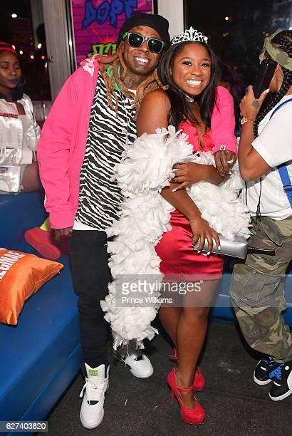 Lil Wayne and Reginae Carter attend Reginae Carters Birthday Party at Suite Lounge on December 2 2016 in Atlanta Georgia