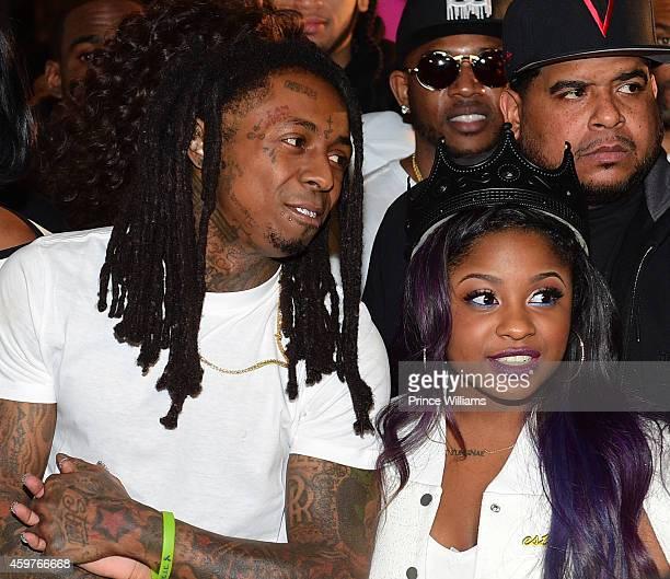 Lil Wayne and Reginae Carter attend Reginae's All White Sweet 16 birthday party at Summerour Studio on November 29 2014 in Atlanta Georgia