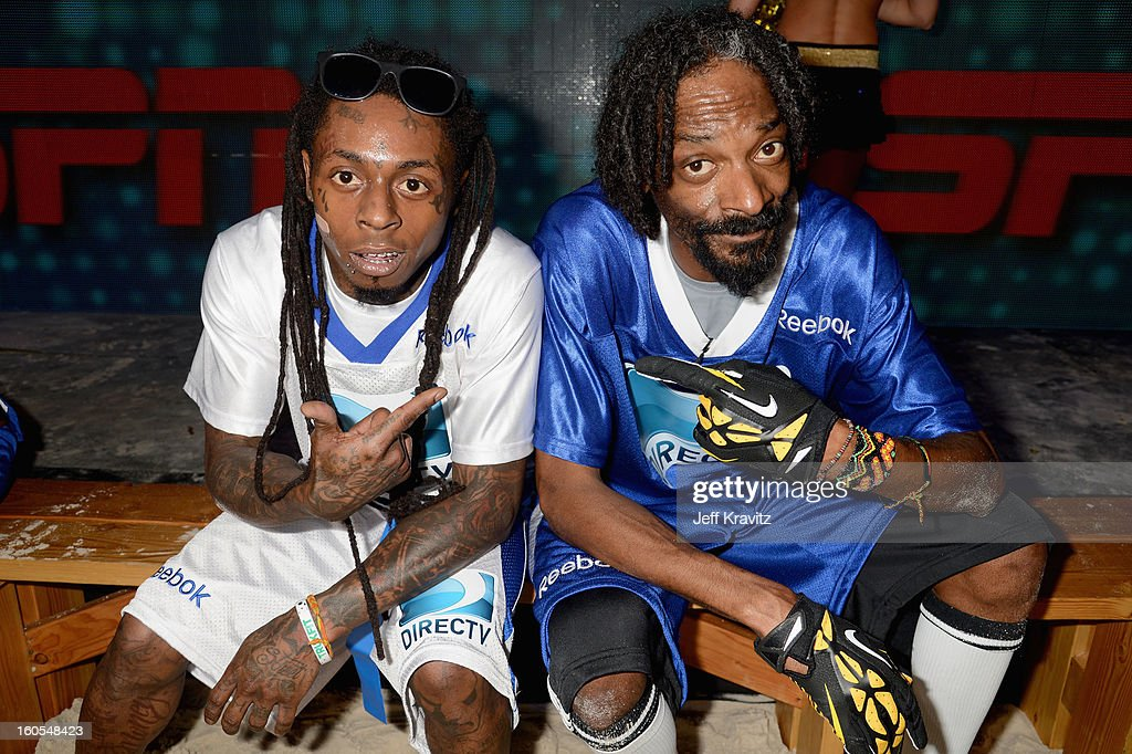 Lil Wayne and Snoop Lion attend DIRECTV'S 7th Annual Celebrity Beach Bowl at DTV SuperFan Stadium at Mardi Gras World on February 2, 2013 in New Orleans, Louisiana.