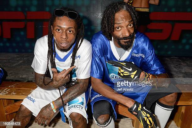 Lil Wayne and Snoop Lion attend DIRECTV'S 7th Annual Celebrity Beach Bowl at DTV SuperFan Stadium at Mardi Gras World on February 2 2013 in New...