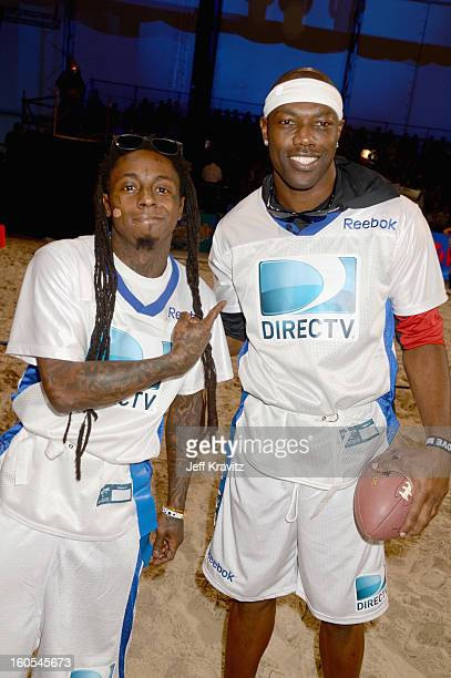 Lil Wayne and Terrell Owens attend DIRECTV'S 7th Annual Celebrity Beach Bowl at DTV SuperFan Stadium at Mardi Gras World on February 2 2013 in New...
