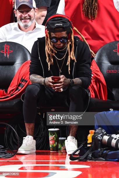 Lil Wayne attends a game between the Houston Rockets and Golden State Warriors during Game Two of the Western Conference Finals of the 2018 NBA...