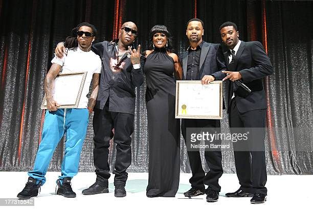 Lil Wayne Birdman BMI Vice Presdent Catherine Brewton Juvenile and RayJ speak onstage at the 2013 BMI RB/HipHop Awards at Hammerstein Ballroom on...