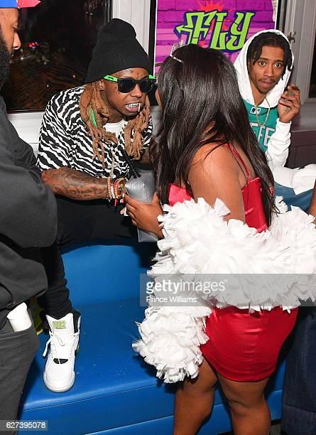 Lil Wayne Hands Reginae Carter $20000 at Reginae Carters Birthday Party at Suite Lounge on December 2 2016 in Atlanta Georgia