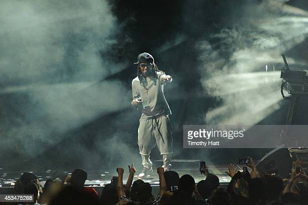 Lil Wayne performs at First Midwest Bank Amphitheatre on August 10 2014 in Tinley Park Illinois