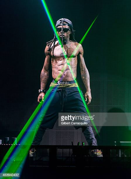 Lil Wayne performs during Drake Vs Lil Wayne Tour at the Susquehanna Bank Center on August 21 2014 in Camden New Jersey