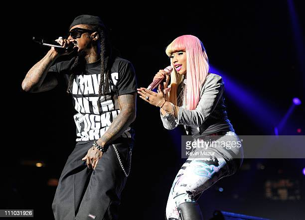 Lil Wayne performs with Nicki Minaj during his I Am Still Music tour at Nassau Veterans Memorial Coliseum on March 28 2011 in Uniondale New York
