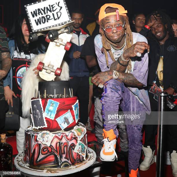 Retransmission with alternate crop LOS ANGELES CA SEPTEMBER 28 Lil Wayne stands next to his birthday cake at his 36th birthday party and Carter V...