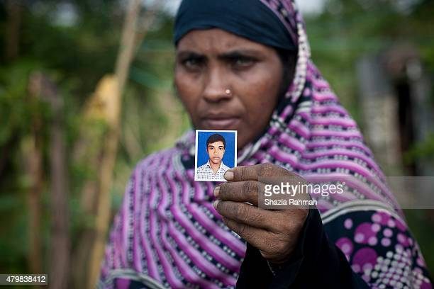 Lila Begum holds a photograph of her son Mohammad Aiaz July 4 2015 in Shamlapur Bangladesh On March 5 2015 Aiaz met a man who promised to take him to...