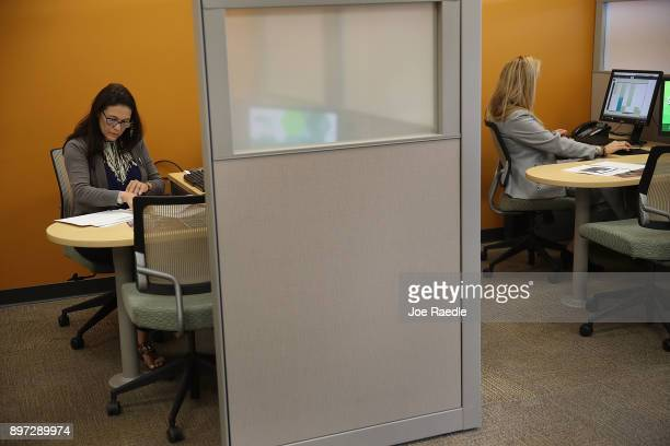 Lila Boadas HR Block tax specialist and Carolina Moratinos HR Block Master Tax Advisor work in the tax preparation specialists office on the day...