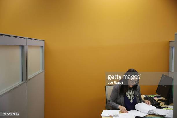 Lila Boadas HR Block tax specialist works on a clients tax form on the day President Donald Trump signed the Republican tax cut bill in Washington DC...
