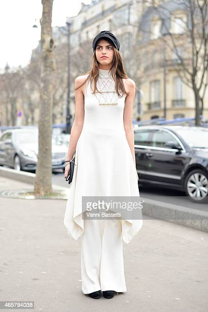 Lila Cardona poses wearing Tandt top and pants and WXYZ necklace on Day 8 of Paris Fashion Week Womenswear FW15 on March 10 2015 in Paris France