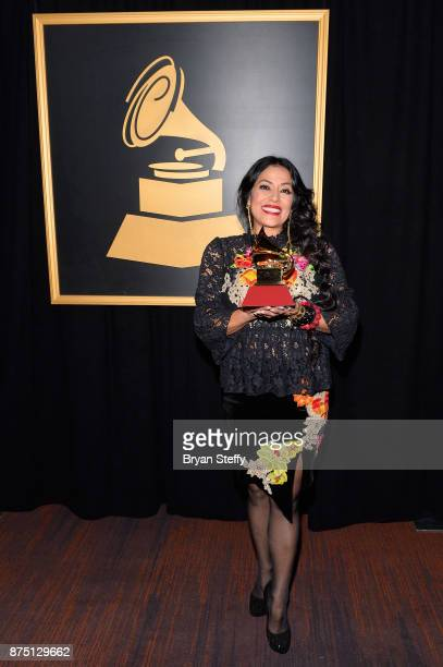 Lila Downs poses with the award for Best Traditional Pop Vocal Album for Salón Lágrimas y Deseo at the Premiere Ceremony during the 18th Annual Latin...